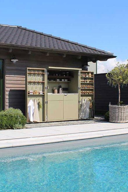 hauser-design-cubic-cupboard-in-a-cabinet-in-moosgruen